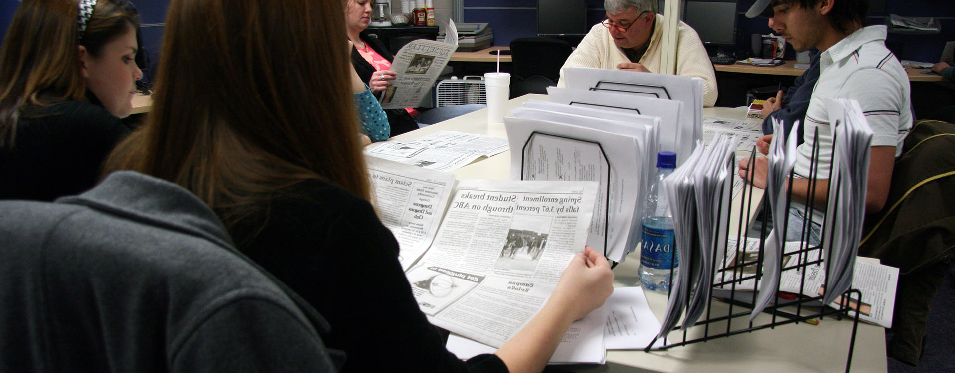 students working in the Settler newspaper office