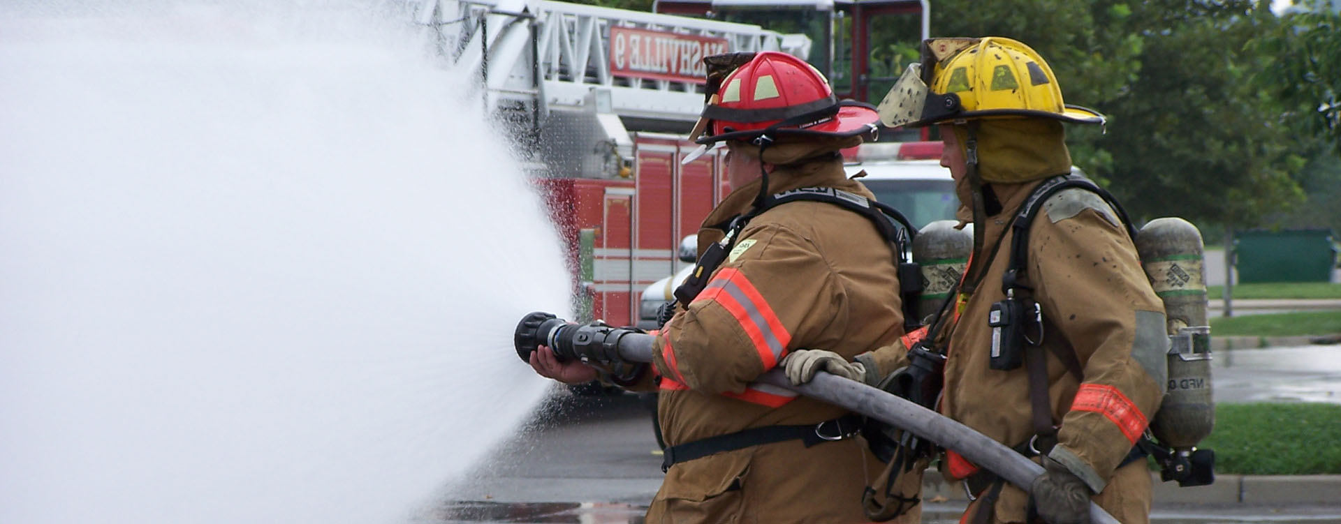 firemen spraying water