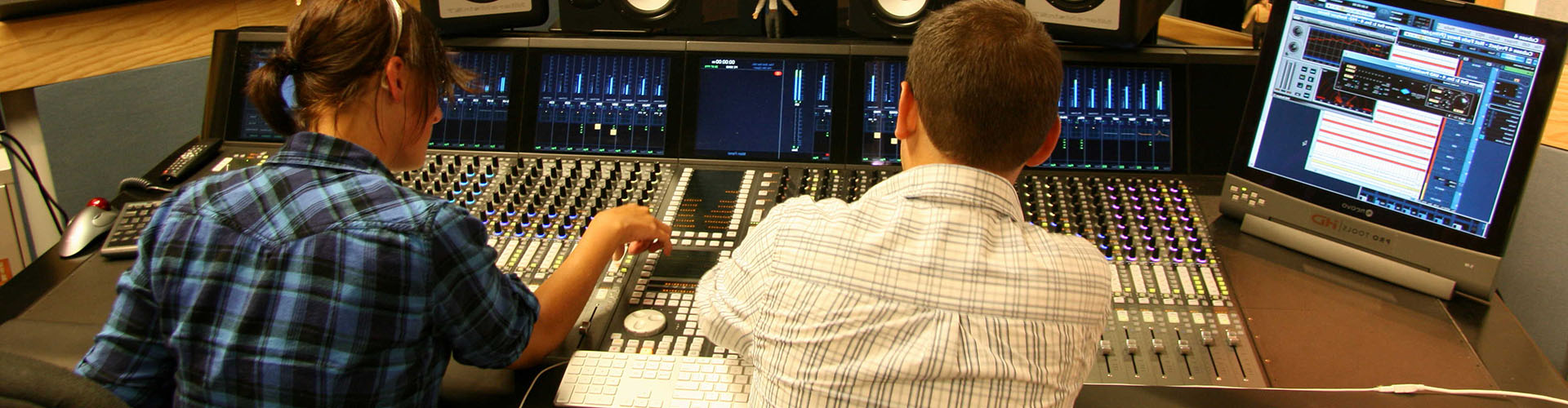 students working in a recording studio