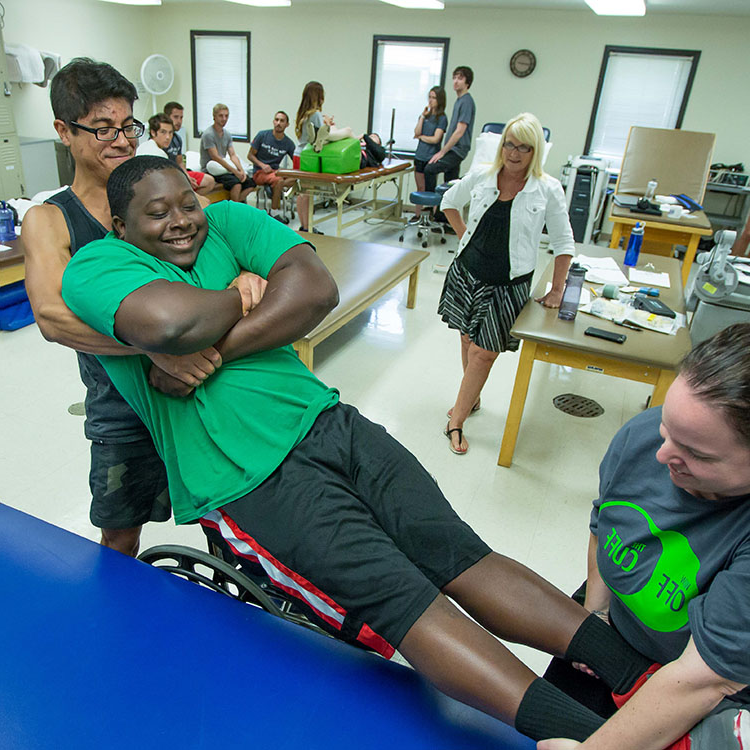 students practicing moving a patient