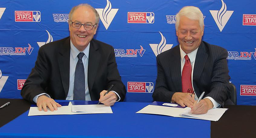Dr. Faulkner and Dr. Fisher sign new Business program partnership