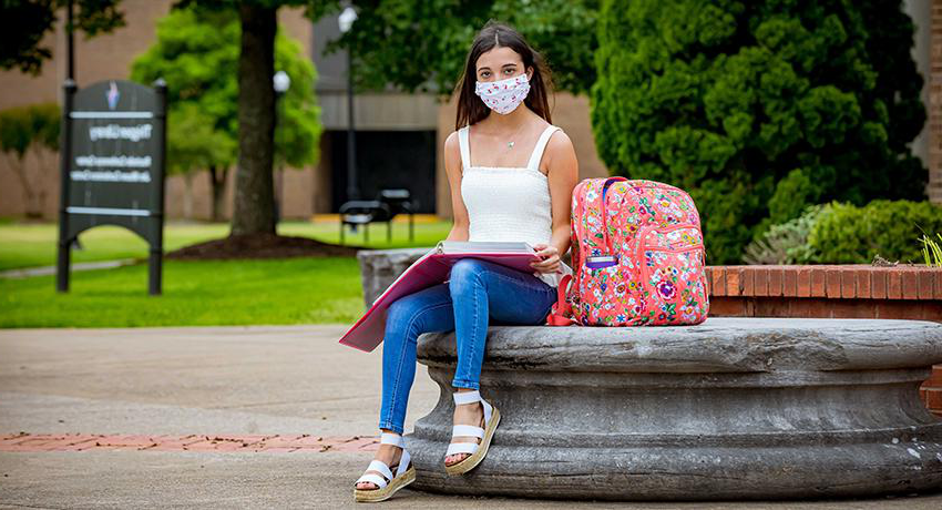 Vol State student in a mask on campus.