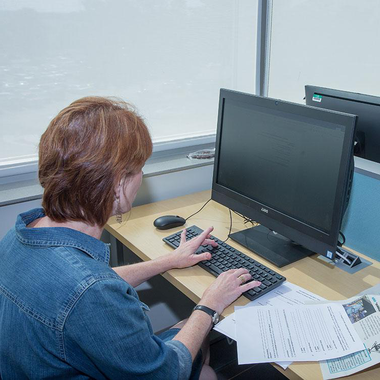 woman typing on a computer